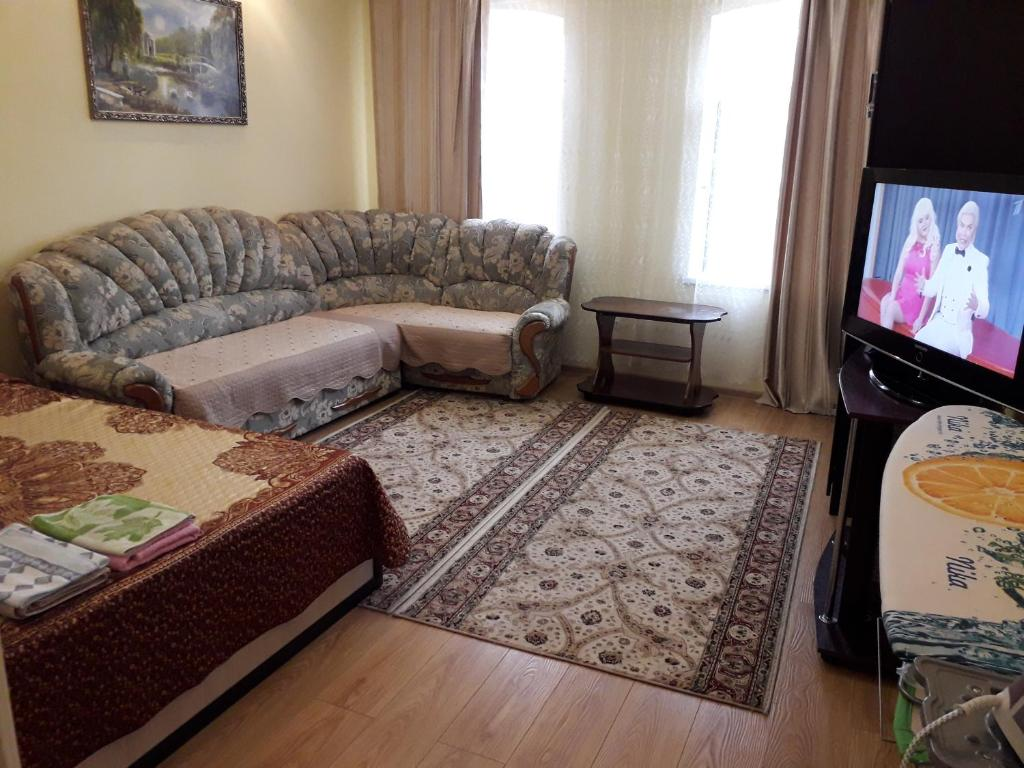 A seating area at 1-комнатная квартира