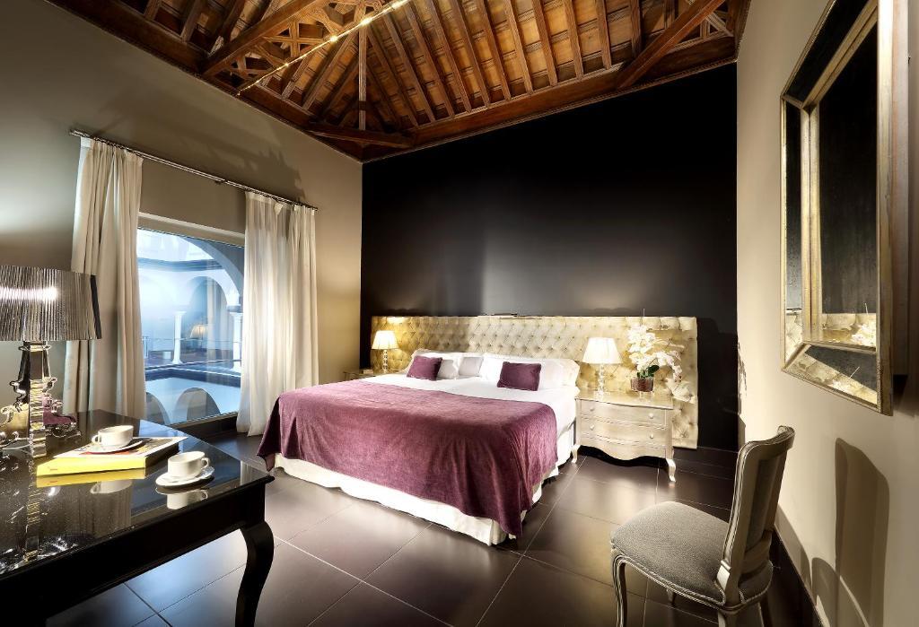 Cama o camas de una habitación en Eurostars Sevilla Boutique