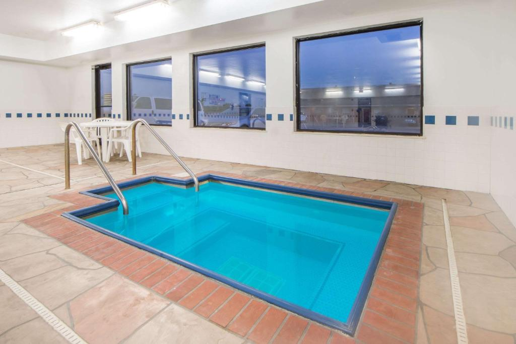 The swimming pool at or near Super 8 by Wyndham Big Cabin/Vinita Area