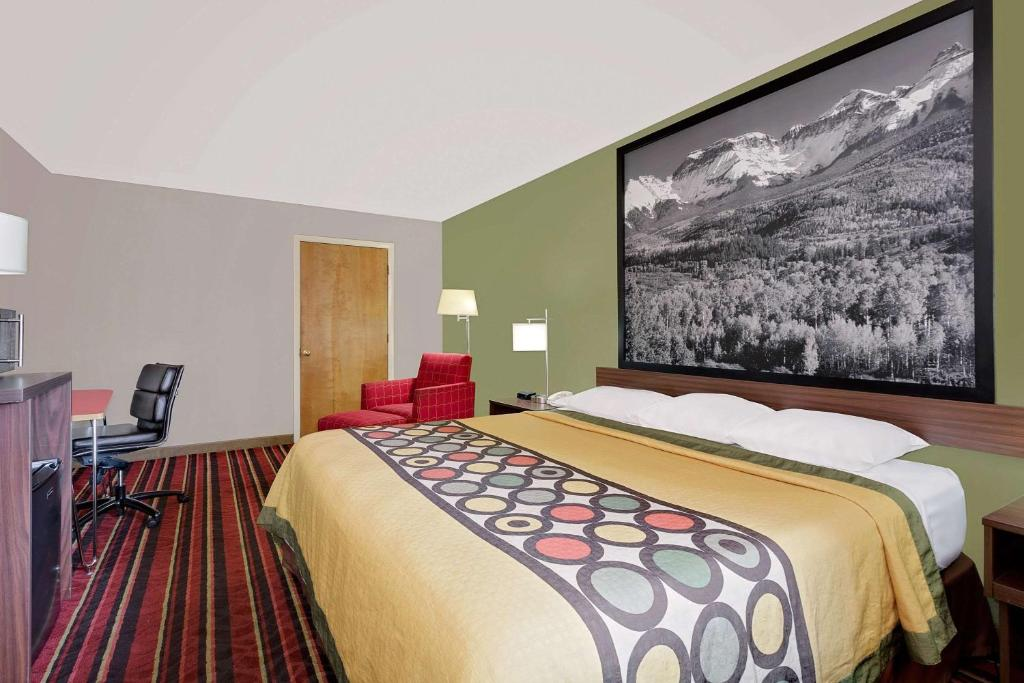 A bed or beds in a room at Super 8 by Wyndham Denver Central