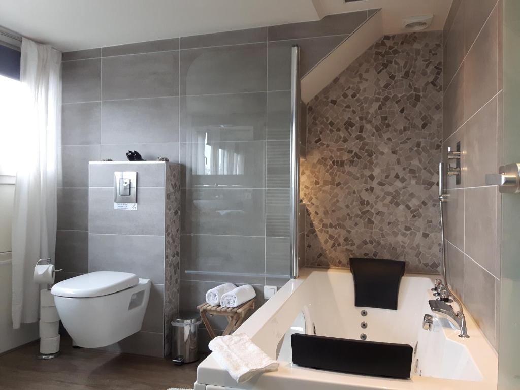 Ein Badezimmer in der Unterkunft Sleep Well Ness Domburg
