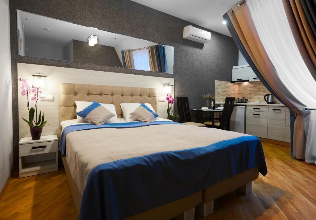 Ліжко або ліжка в номері ANTARES Apart hotel