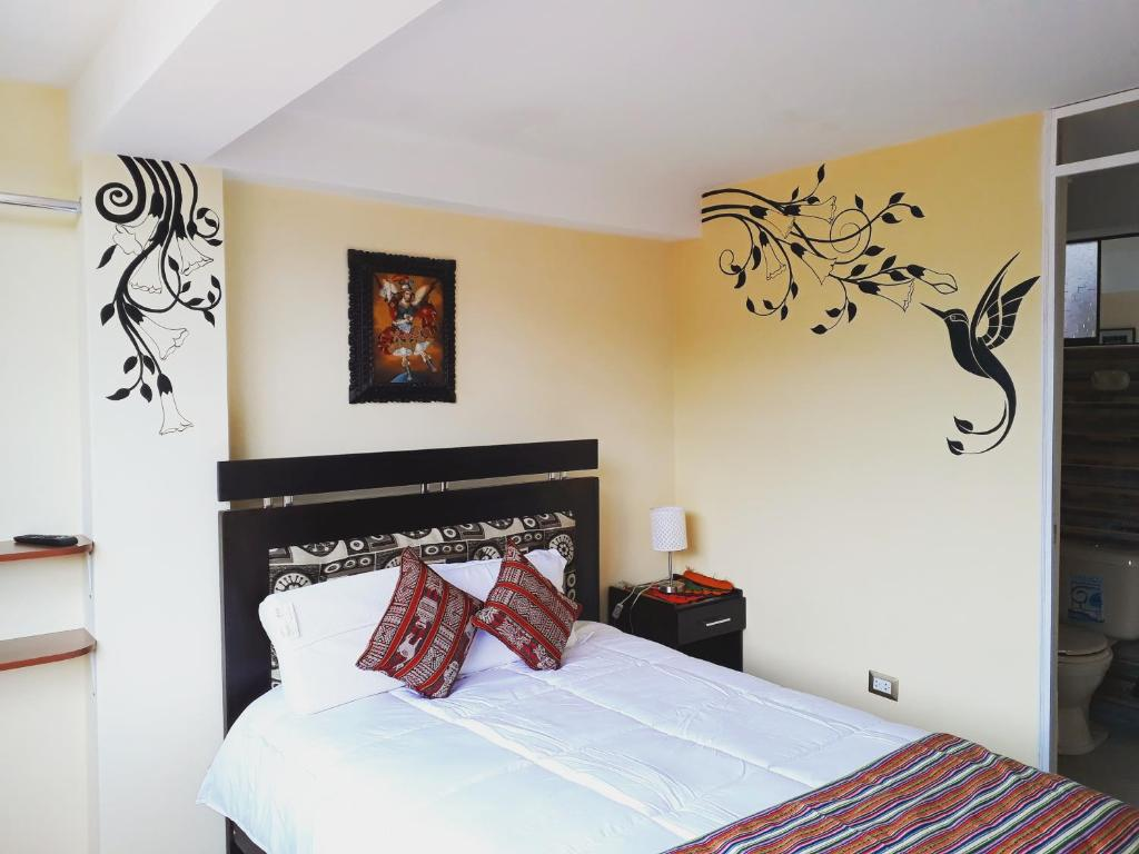A bed or beds in a room at Yanuy Culinary Guest House