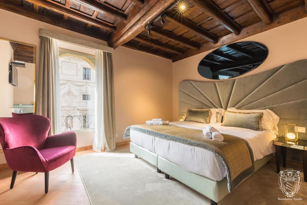 Un ou plusieurs lits dans un hébergement de l'établissement Residenza Spada