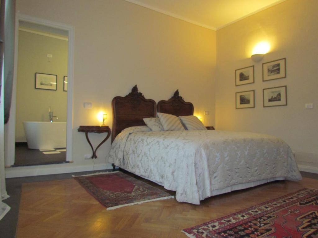 Een bed of bedden in een kamer bij L'Approdo di Sant'Agostino