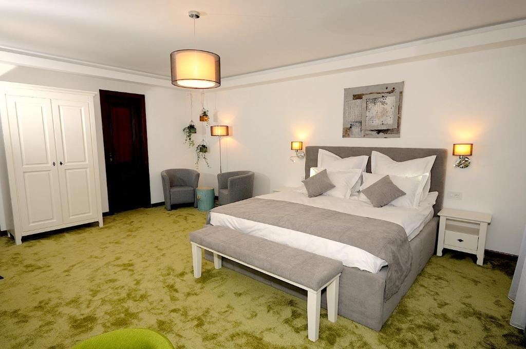 A bed or beds in a room at Arce Boutique Hotel