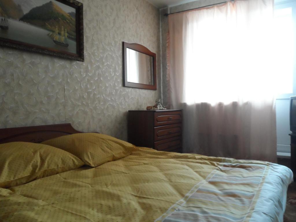 Кровать или кровати в номере 2 комнатные апартаменты ВДНХ