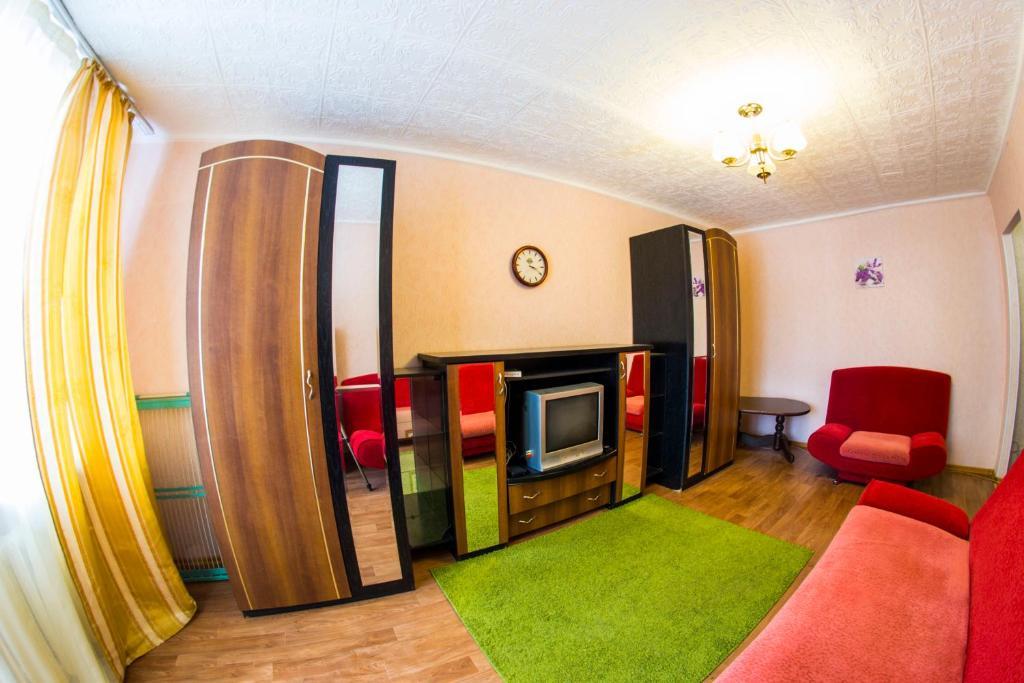 A seating area at RENT-сервис Apartment Irtyshskaya naberezhnaya 15b
