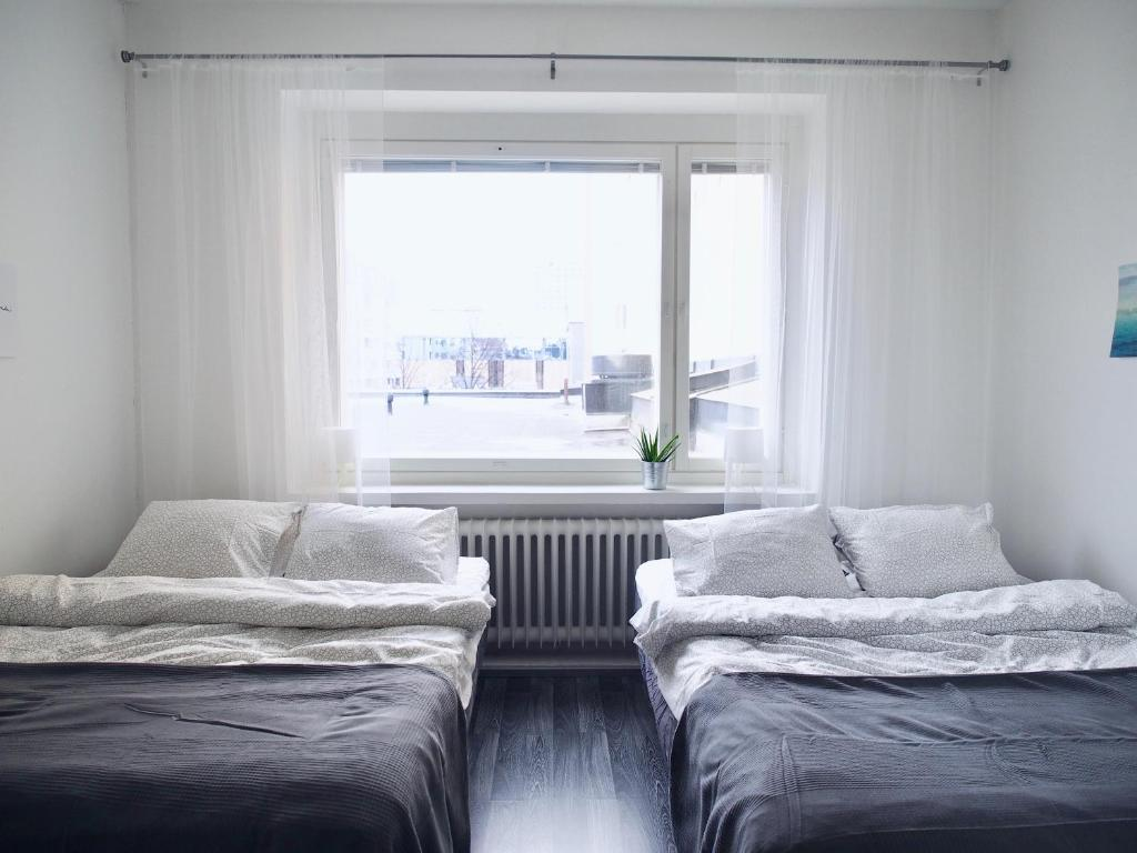 "Vuode tai vuoteita majoituspaikassa 2ndhomes Tampere ""Koskipuisto"" Apartment - Premium Downtown Apt with Own Sauna & a Tapas Restaurant Downstairs"