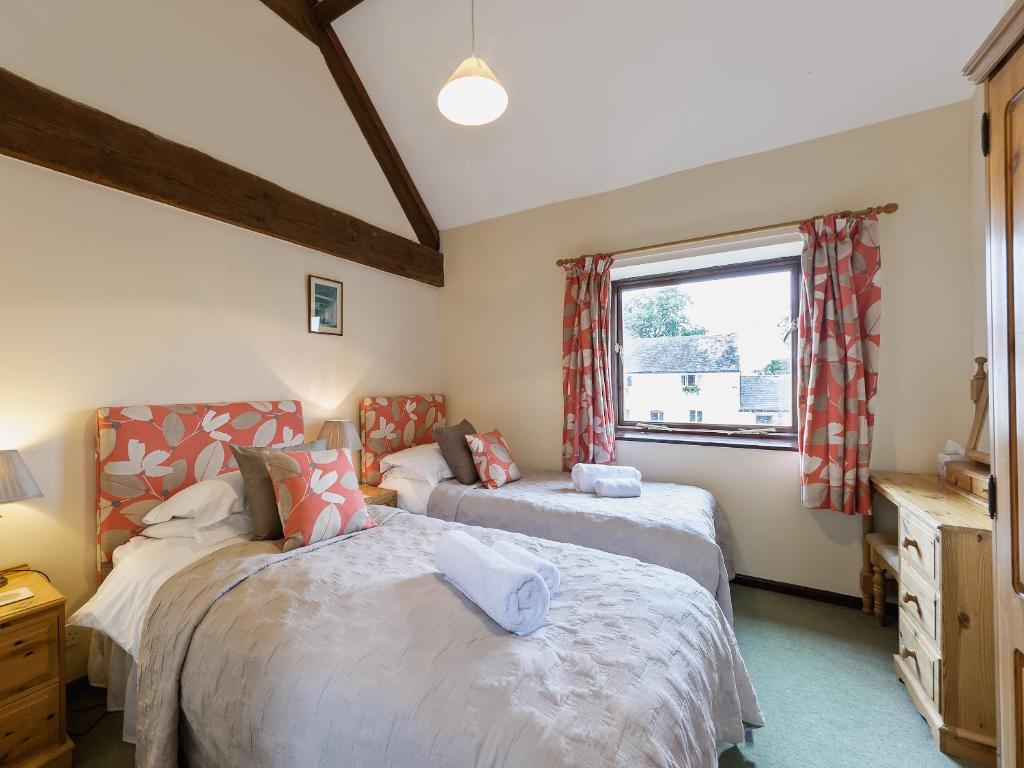 A bed or beds in a room at Wheathill