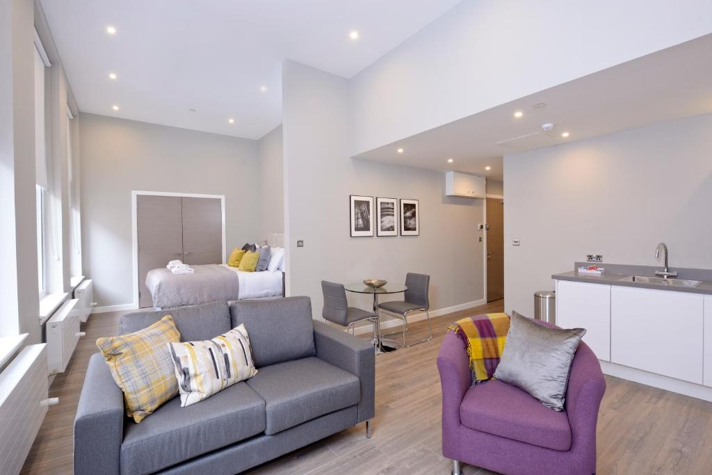 A seating area at Destiny Scotland Apartments at Nelson Mandela Place