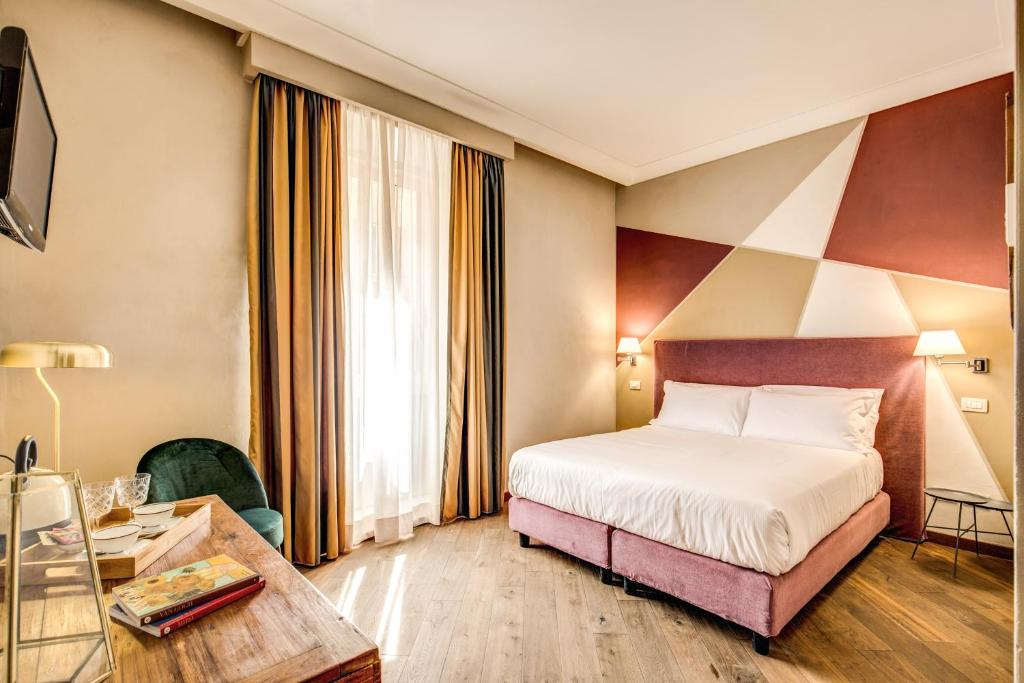 A bed or beds in a room at Boutique Hotel Galatea