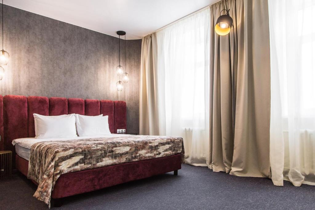 Кровать или кровати в номере Нью Стар Отель