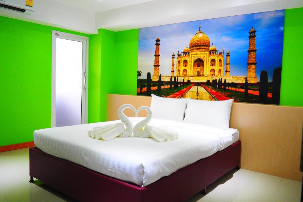 A bed or beds in a room at Blue Orchids Hotel