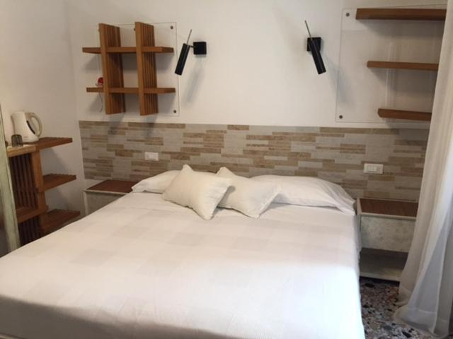 A bed or beds in a room at 3C B&B