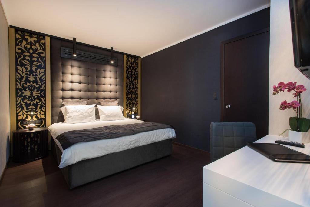 Кровать или кровати в номере Egnatia Palace Hotel & Spa