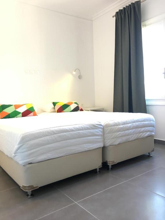 Ένα ή περισσότερα κρεβάτια σε δωμάτιο στο Hotel Kamelia