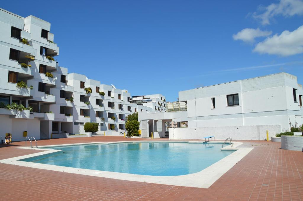 The swimming pool at or near Amazing Beach & Pool Apartment with Garden