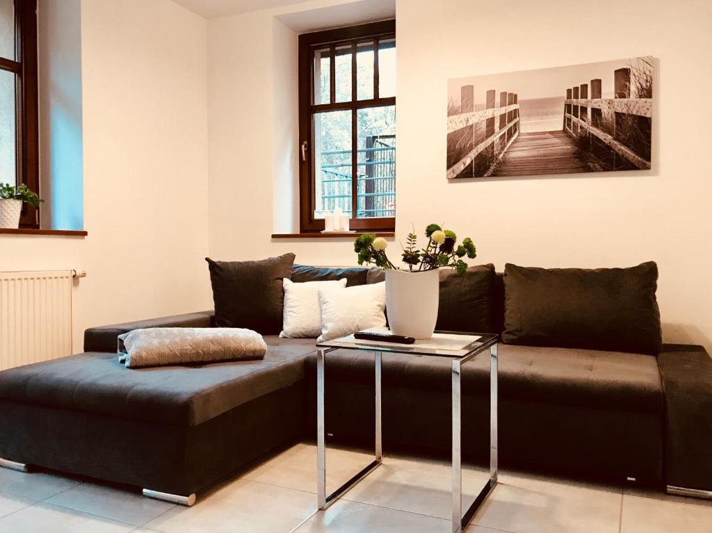 A seating area at Apartamenty Aleksandry Apartament przy Parku
