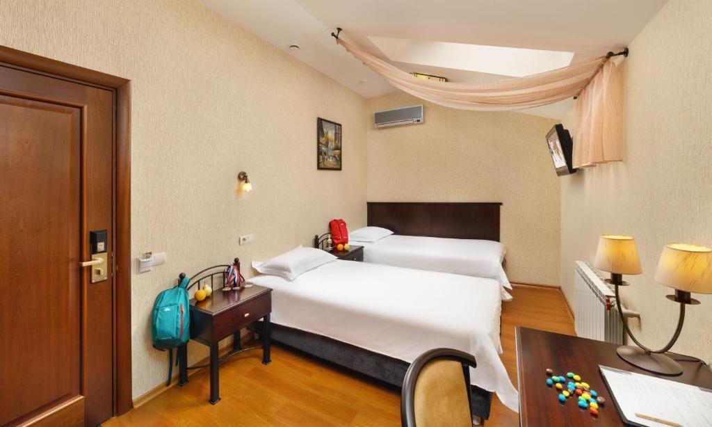 Кровать или кровати в номере Отель Парус