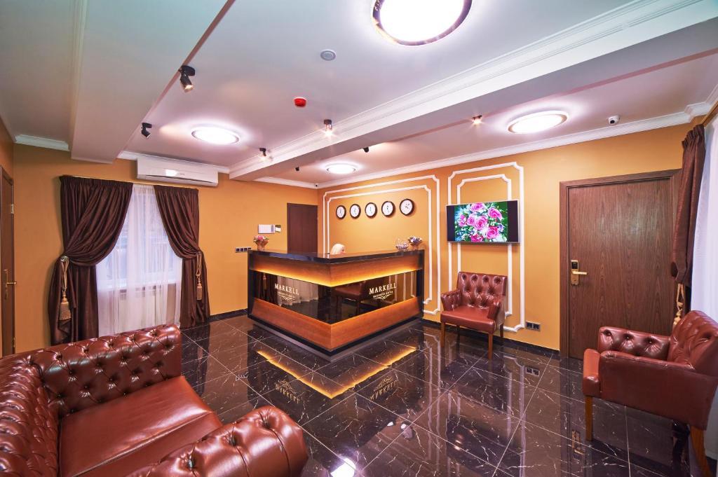 Лобби или стойка регистрации в Markell Hotel