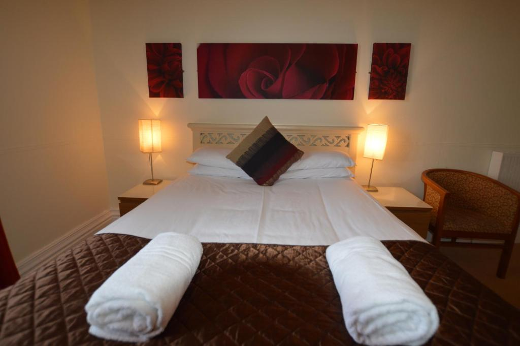 A bed or beds in a room at The Grey Walls