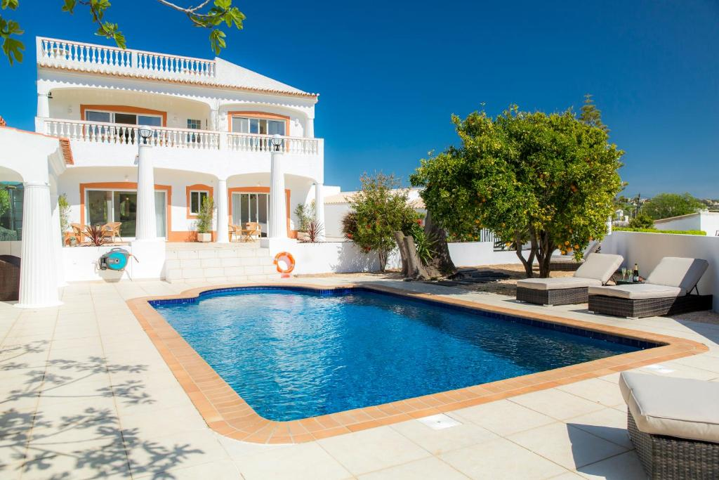 The swimming pool at or near Casa Luisandra Boutique B&B