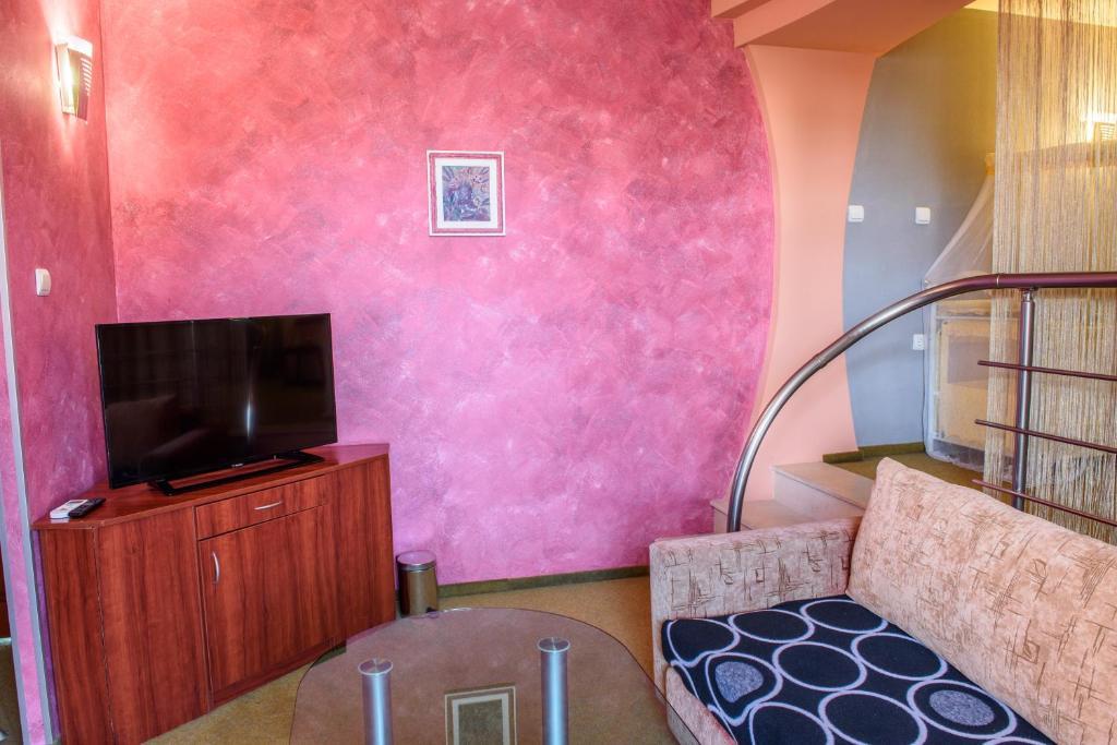 Телевизор и/или развлекательный центр в Hotel Kapri