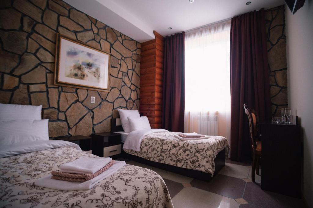 Кровать или кровати в номере Гостиничный Комплекс Арт-Отель