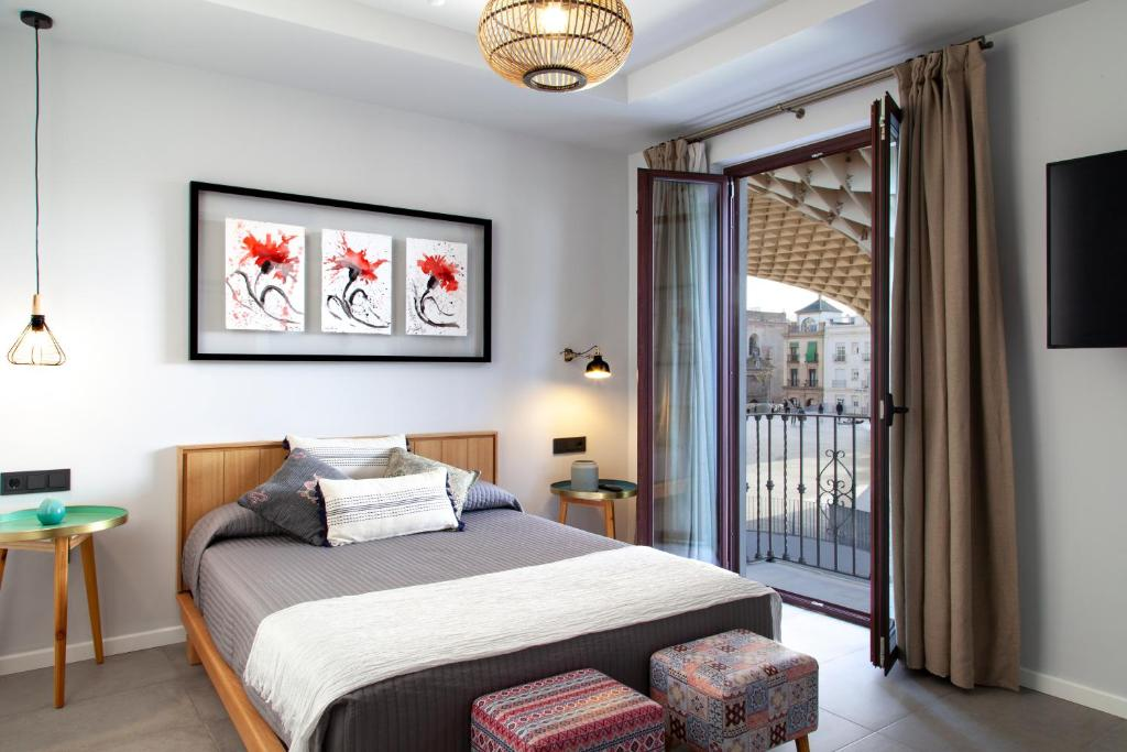 A bed or beds in a room at Welldone Metropol