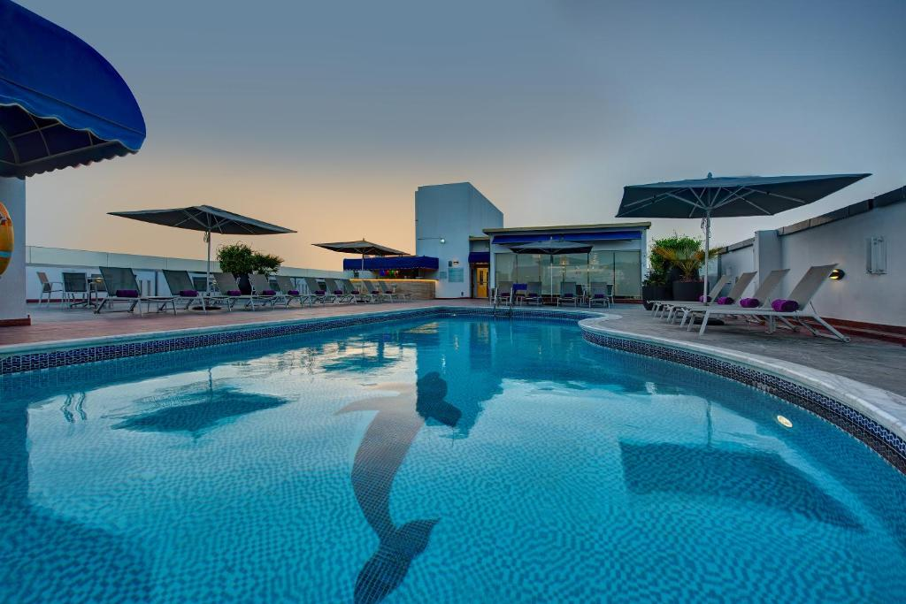 The swimming pool at or close to J5 RIMAL Hotel Apartments