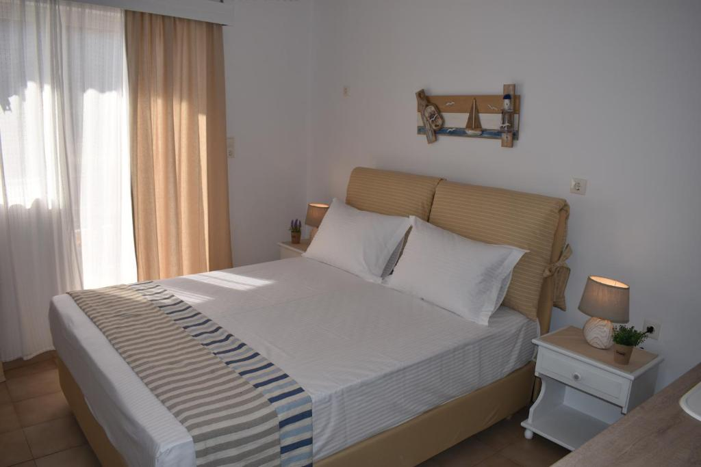 A bed or beds in a room at Filippos