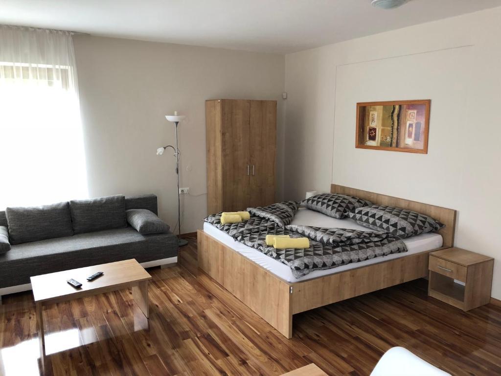 Postel nebo postele na pokoji v ubytování Evička Penzion