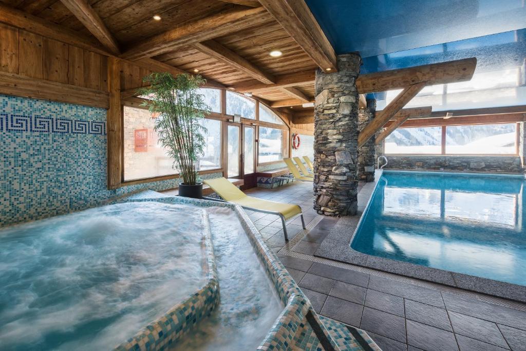 The swimming pool at or close to CGH Résidences & Spas Les Fermes de Ste Foy