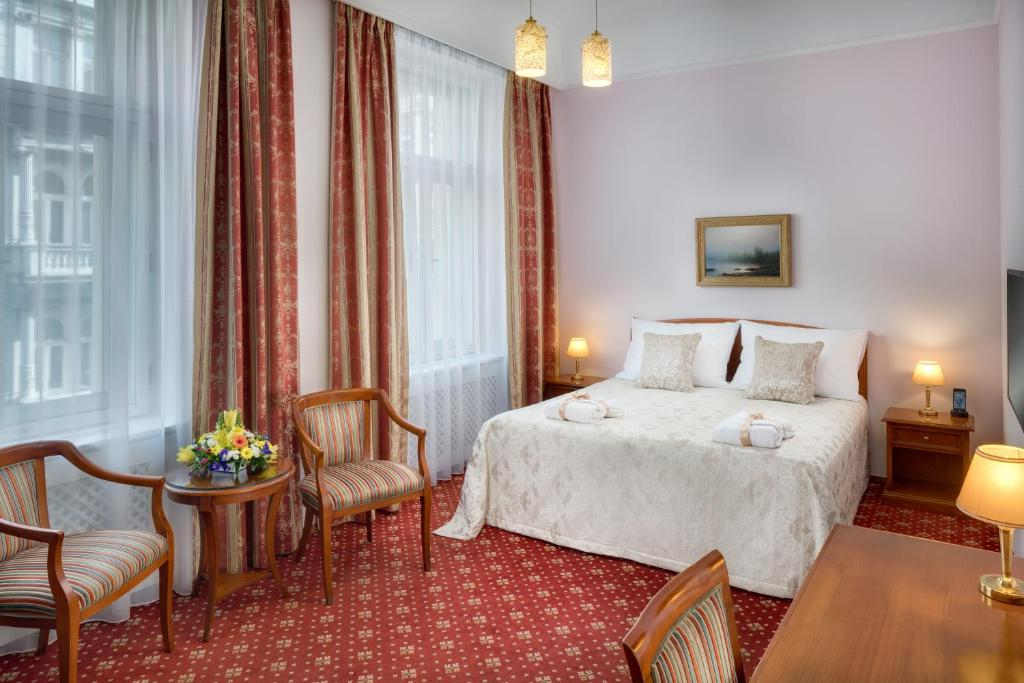 Кровать или кровати в номере Boutique Hotel Seven Days
