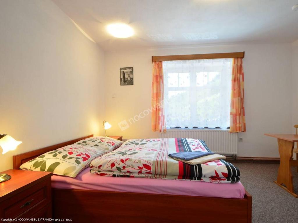 Postel nebo postele na pokoji v ubytování Penzion Pod Ozvěnou