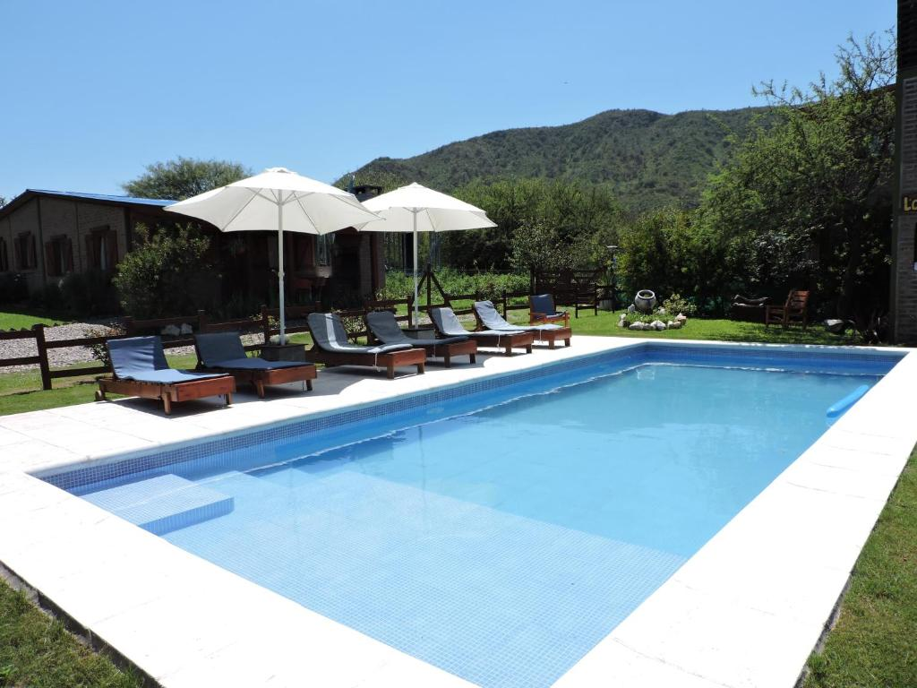 The swimming pool at or near CABAÑAS LOS COCKERS