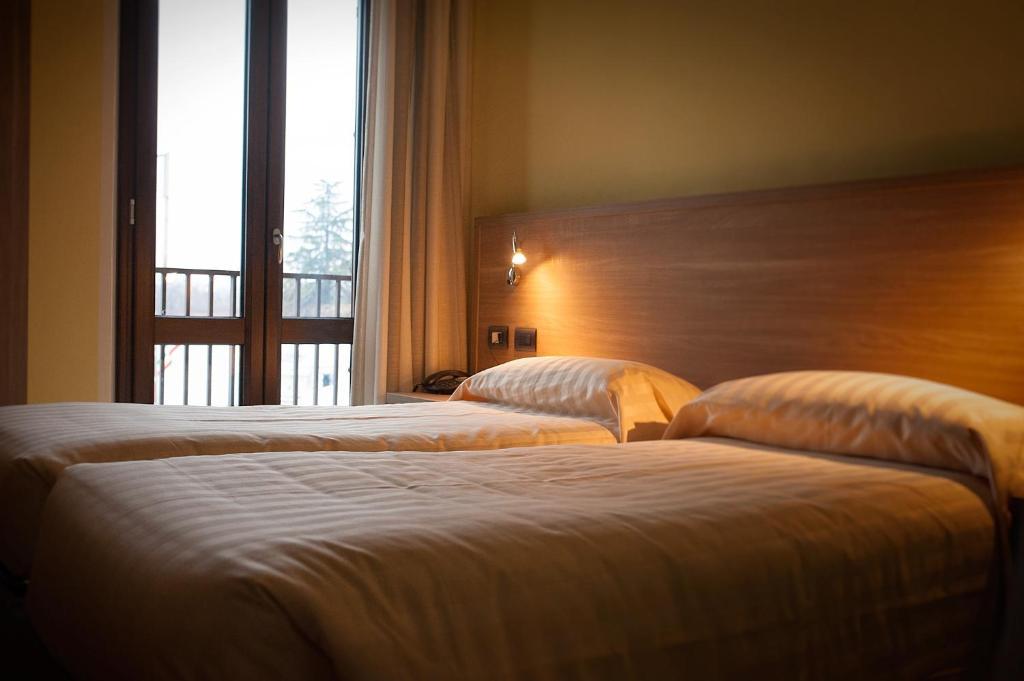 Letto o letti in una camera di Hotel Ristorante Piccadilly