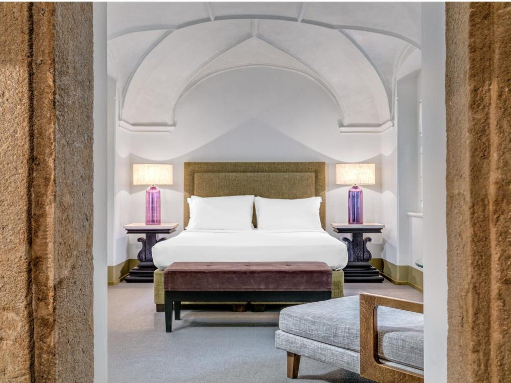 A bed or beds in a room at Augustine, a Luxury Collection Hotel, Prague