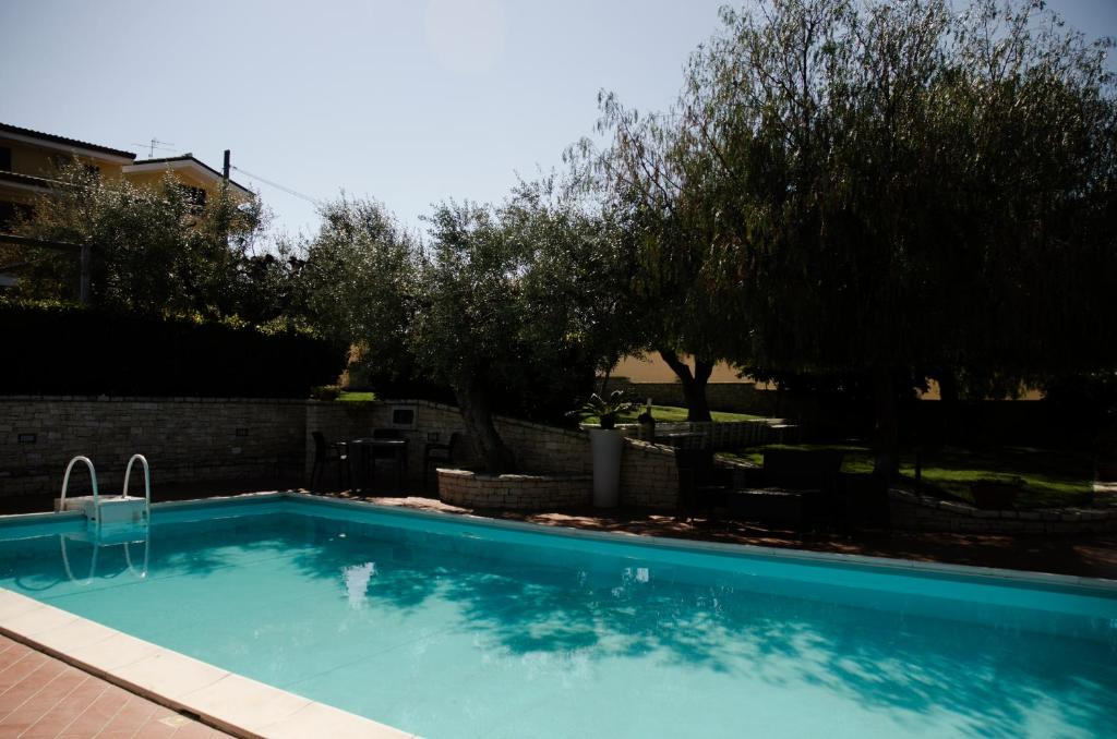 The swimming pool at or near Lo Scacciapensieri