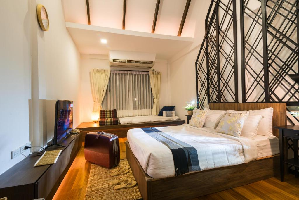 A bed or beds in a room at Siam Nitra Boutique Hotel