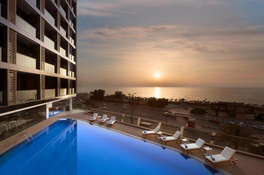The swimming pool at or near Wyndham Garden Ajman Corniche