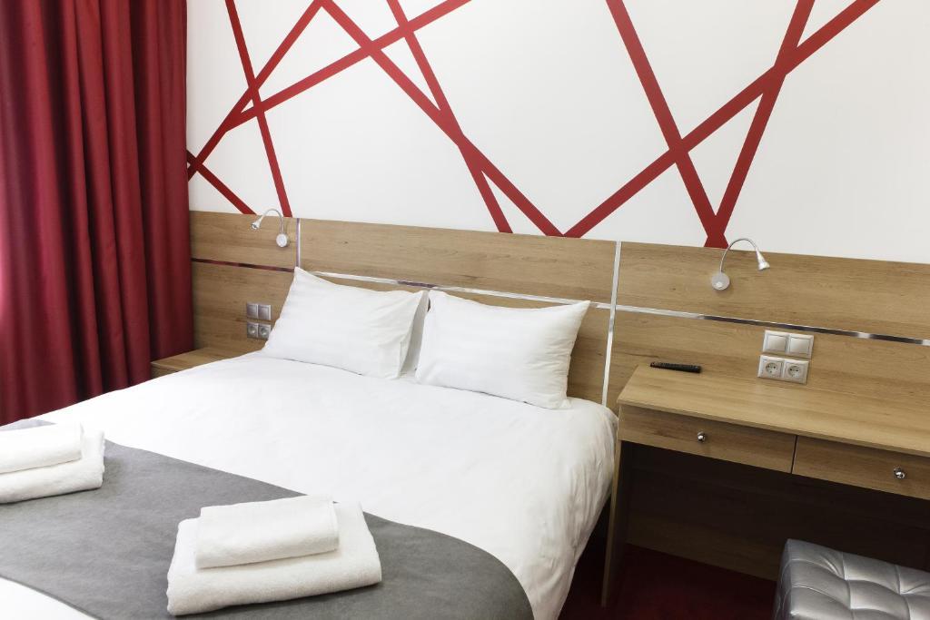 Кровать или кровати в номере Канна