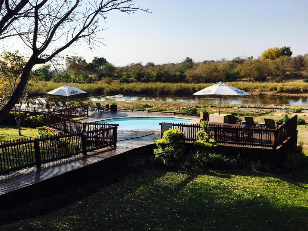 The swimming pool at or near Sabie River Bush Lodge