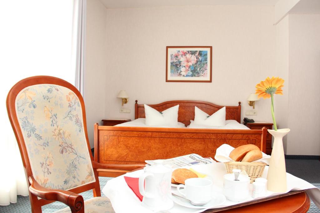 Кровать или кровати в номере Hotel und Restaurant Ascania