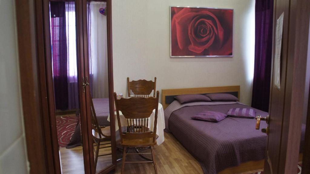 A bed or beds in a room at Usadba Yurlovo