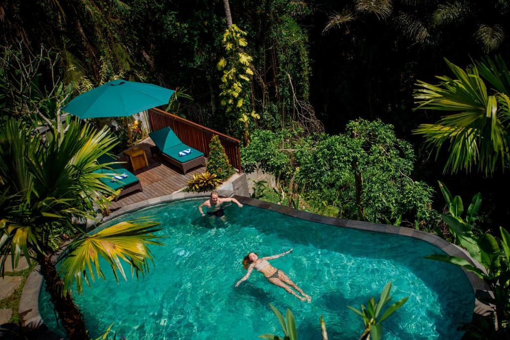 The swimming pool at or near Taman Amartha Hotel