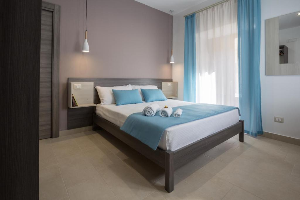A bed or beds in a room at Casa dell'Aromatario b&b