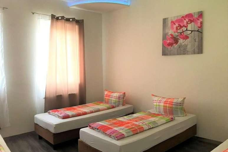 """A bed or beds in a room at Hostel """"Berkut"""""""