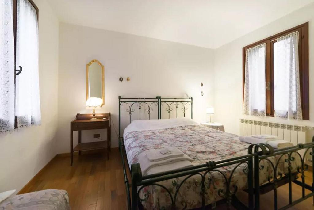 A bed or beds in a room at San Barnaba Artist's district house